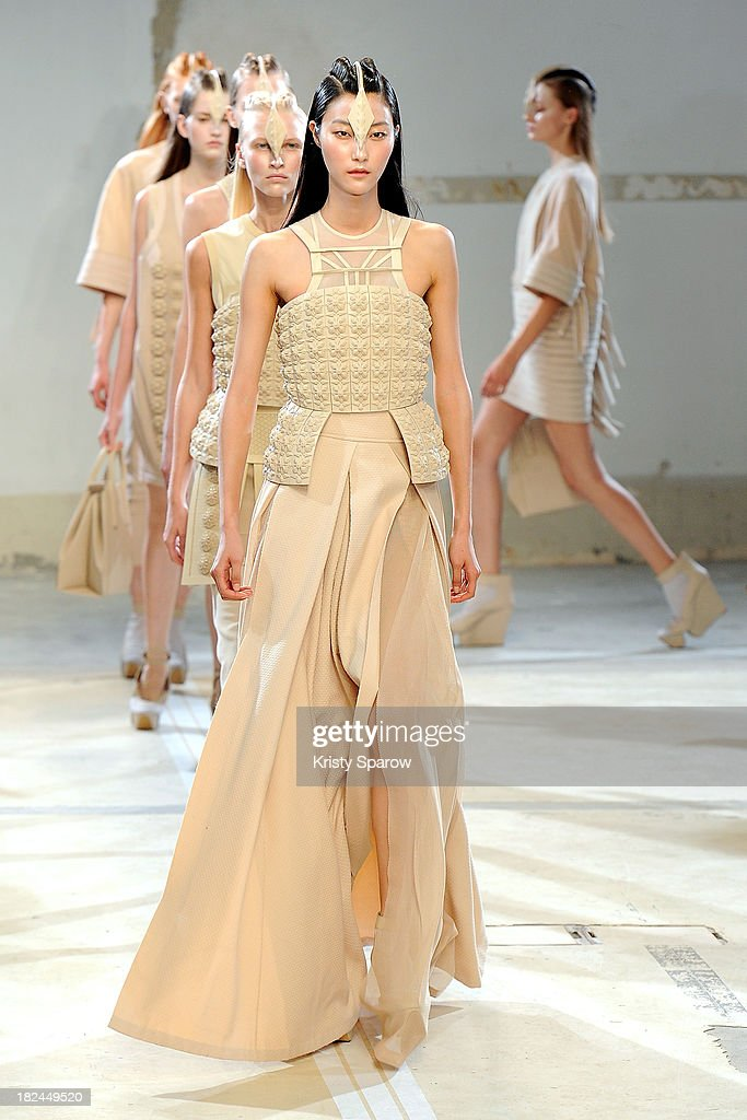 Models walk the runway during the Hexa By Kuho show as part of Paris Fashion Week Womenswear Spring/Summer 2014 on September 29, 2013 in Paris, France.
