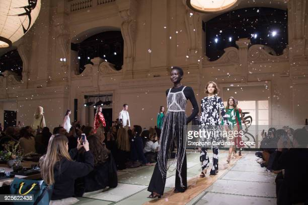Models walk the runway during the HM show as part of the Paris Fashion Week Womenswear Fall/Winter 2018/2019 on February 28 2018 in Paris France