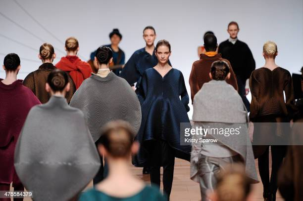 Models walk the runway during the Issey Miyake show as part of Paris Fashion Week Womenswear Fall/Winter 20142015 on February 28 2014 in Paris France