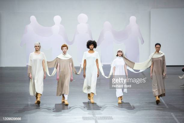 Models walk the runway during the Issey Miyake show as part of the Paris Fashion Week Womenswear Fall/Winter 2020/2021 at Lycee Carnot on March 01,...