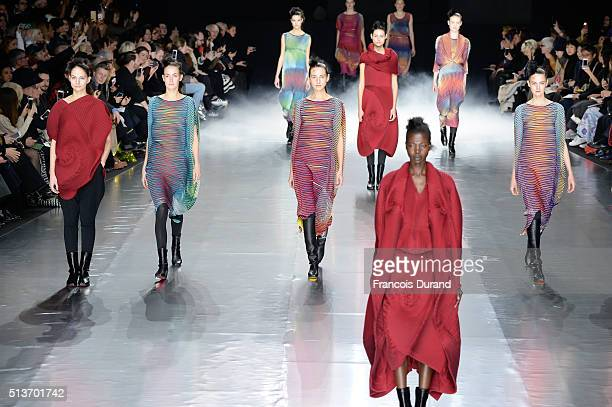 Models walk the runway during the Issey Miyake show as part of the Paris Fashion Week Womenswear Fall/Winter 2016/2017 on March 4 2016 in Paris France