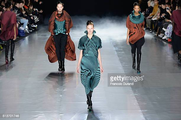 Models walk the runway during the Issey Miyake show as part of the Paris Fashion Week Womenswear Fall/Winter 2016/2017 on March 4, 2016 in Paris,...