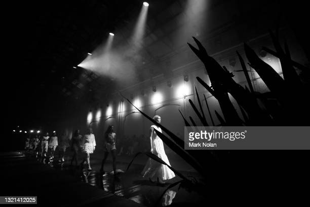 Models walk the runway during the IXIAH show during Afterpay Australian Fashion Week 2021 Resort '22 Collections at Carriageworks on June 01, 2021 in...