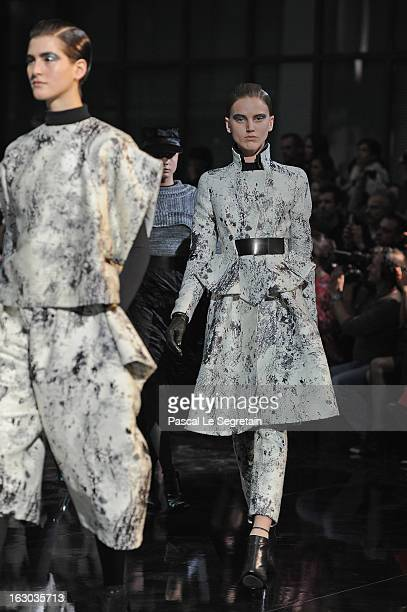 Models walk the runway during the John Galliano Fall/Winter 2013 ReadytoWear show as part of Paris Fashion Week at Le Centorial on March 3 2013 in...