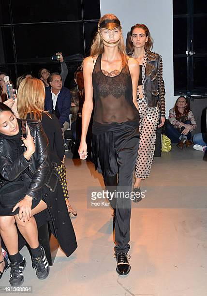 Models walk the runway during the John Galliano show as part of the Paris Fashion Week Womenswear Spring/Summer 2016 on October 4 2015 in Paris France