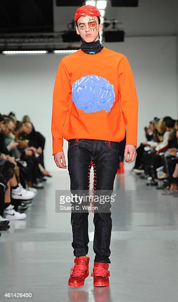 Models walk the runway during the Katie Eary show at the London Collections Men AW15 at Victoria House on January 12 2015 in London England