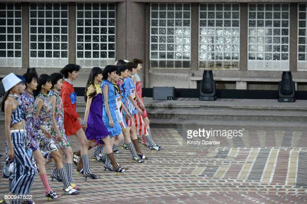 Models walk the runway during the Kenzo Menswear Spring/Summer 2018 show as part of Paris Fashion Week on June 25 2017 in Paris France