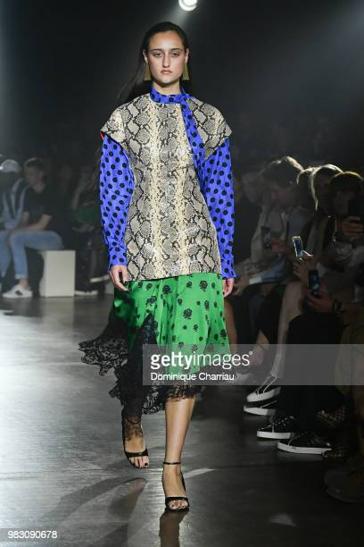 Models walk the runway during the Kenzo Menswear /womenswear Spring/Summer 2019 show as part of Paris Fashion Week on June 24 2018 in Paris France