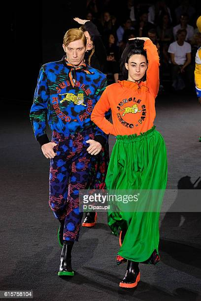 Models walk the runway during the KENZO x HM Collection launch event at Pier 36 on October 19 2016 in New York City