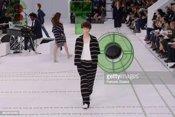 Models walk the runway during the Lacoste show as part of the Paris Fashion Week Womenswear Spring/Summer 2018 on September 27 2017 in Paris France