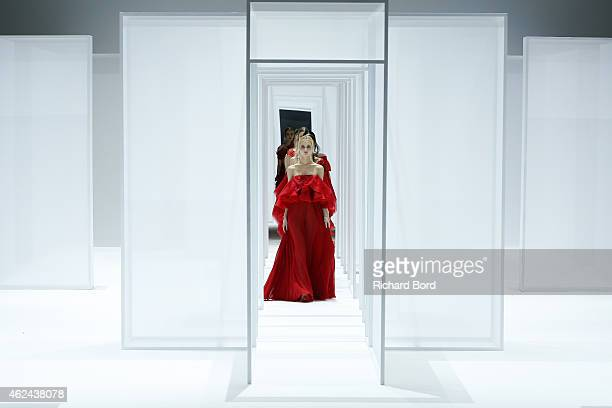 Models walk the runway during the Lan Yu show as part of the Paris Fashion Week Haute Couture Spring/Summer 2015 at the Grand Palais on January 28...