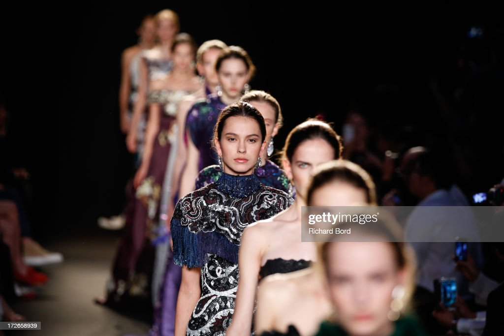 Models walk the runway during the Laurence Xu show as part of Paris Fashion Week Haute-Couture Fall/Winter 2013-2014 at Pavillon Cambon on July 4, 2013 in Paris, France.