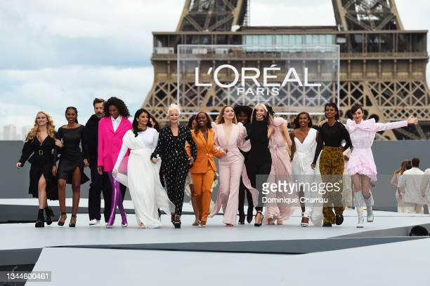 """Models walk the runway during the """"Le Defile L'Oreal Paris 2021"""" Womenswear Spring/Summer 2022 show as part of Paris Fashion Week on October 03, 2021..."""