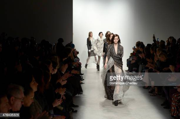 Models walk the runway during the Leonard Paris show as part of the Paris Fashion Week Womenswear Fall/Winter 20142015 on March 3 2014 in Paris France