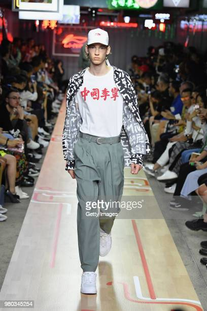 Models walk the runway during the LiNing Spring/Summer 2019 show as part of Paris Fashion Week at Les Nuits Fauves on June 21 2018 in Paris France