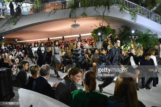 Models walk the runway during the Louis Vuitton Cruise 2020 Fashion Show at JFK Airport on May 08 2019 in New York City