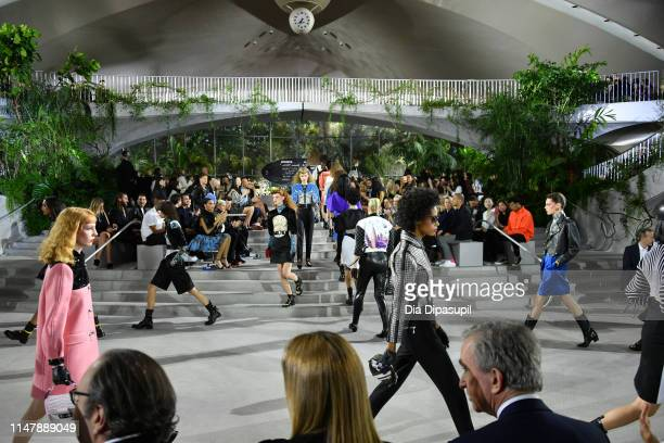 Models walk the runway during the Louis Vuitton Cruise 2020 Fashion Show at JFK Airport on May 08, 2019 in New York City.