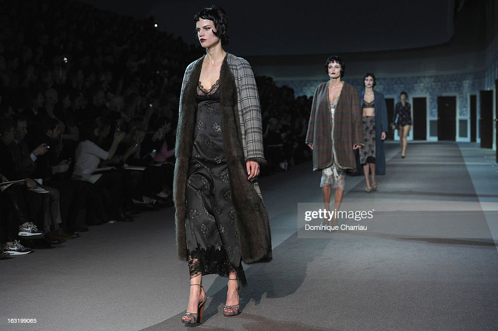 Models walk the runway during the Louis Vuitton Fall/Winter 2013 Ready-to-Wear show as part of Paris Fashion Week on March 6, 2013 in Paris, France.