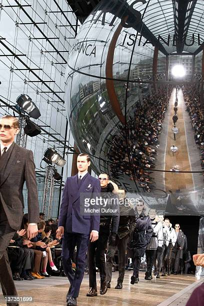 Models walk the runway during the Louis Vuitton Menswear Autumn/Winter 2013 show as part of Paris Fashion Week on January 19 2012 in Paris France
