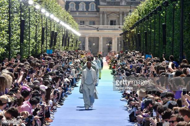 Models walk the runway during the Louis Vuitton Menswear Spring/Summer 2019 show as part of Paris Fashion Week on June 21 2018 in Paris France