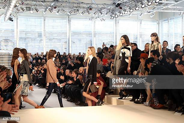 Models walk the runway during the Louis Vuitton show as part of the Paris Fashion Week Womenswear Fall/Winter 20142015 on March 5 2014 in Paris France