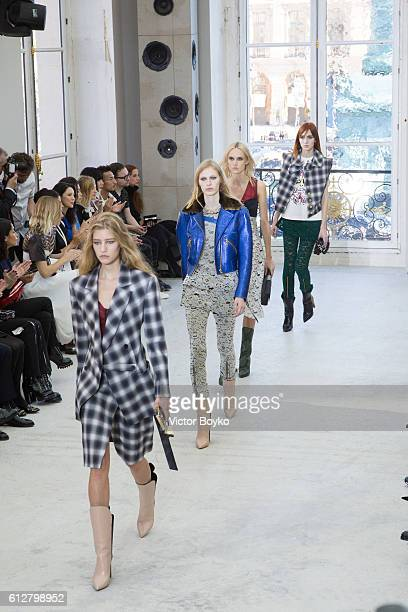 Models walk the runway during the Louis Vuitton show as part of the Paris Fashion Week Womenswear Spring/Summer 2017 on October 5 2016 in Paris France