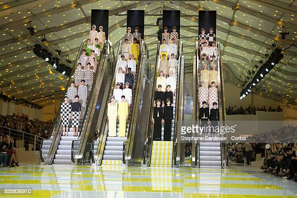 Models walk the runway during the Louis Vuitton Spring/Summer 2013 show as part of Paris Fashion Week at Cour Carre du Louvre in Paris