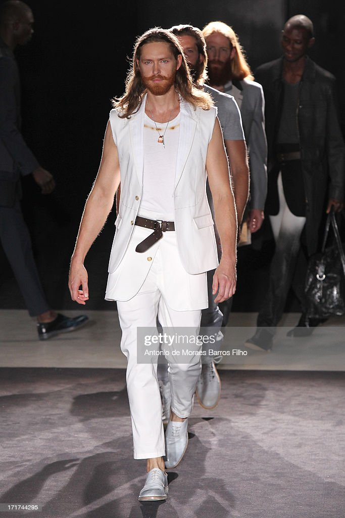 Models walk the runway during the Maison Martin Margiela Menswear Spring/Summer 2014 Show As Part Of The Paris Fashion Week on June 28, 2013 in Paris, France.