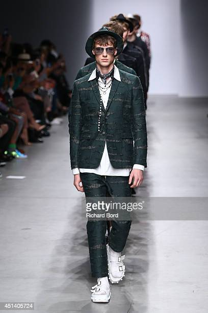Models walk the runway during the Miharayasuhiro show as part of the Paris Fashion Week Menswear Spring/Summer 2015 at Palais de Tokyo on June 28,...