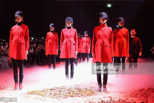 Models walk the runway during the Moncler Gamme Rouge show as part of the Paris Fashion Week Womenswear Fall/Winter 2015/2016 on March 11 2015 in...