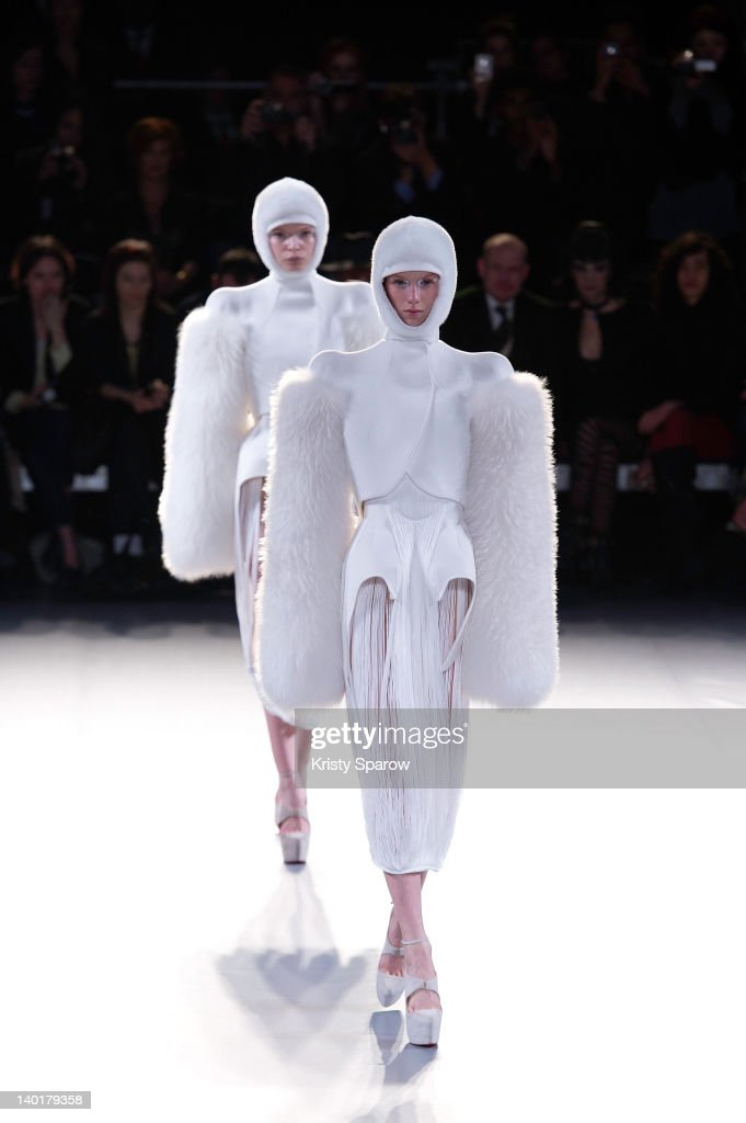 Models walk the runway during the Mugler Ready-To-Wear Fall/Winter 2013 show as part of Paris Fashion Week on February 29, 2012 in Paris, France.