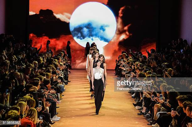 Models walk the runway during the Mugler show as part of the Paris Fashion Week Womenswear Fall/Winter 2016/2017 on March 5 2016 in Paris France