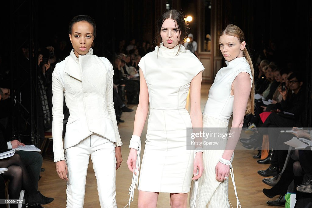 Models walk the runway during the 'New Stylists Podium, 4th Edition' Fashion Show at the Hotel Westin on February 4, 2013 in Paris, France.