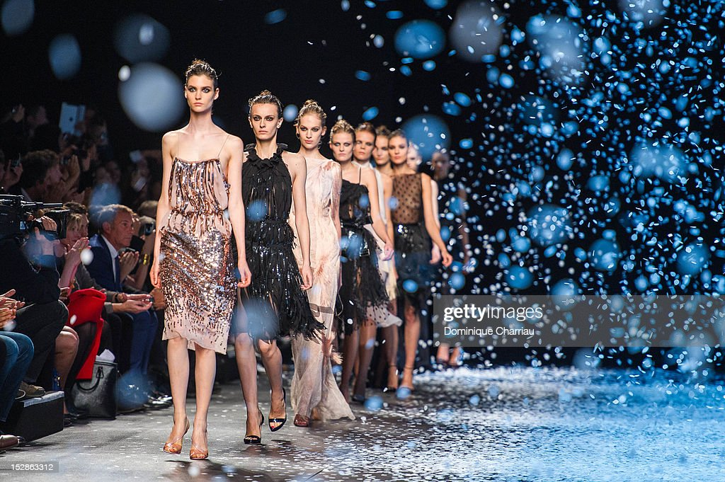 Models walk the runway during the Nina Ricci Spring / Summer 2013 show as part of Paris Fashion Week at Espace Ephemere Tuileries on September 27, 2012 in Paris, France.
