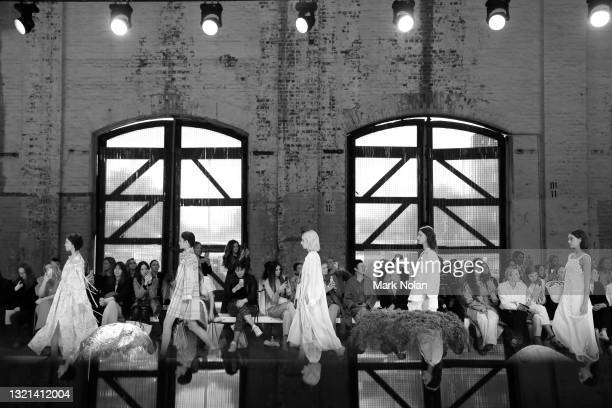 Models walk the runway during the Oroton show during Afterpay Australian Fashion Week 2021 Resort '22 Collections at Carriageworks on June 01, 2021...