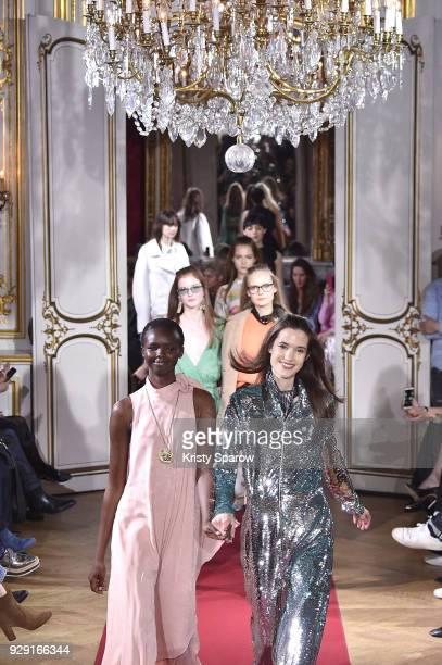 Models walk the runway during the Paul Joe show as part of Paris Fashion Week Womenswear Fall/Winter 2018/2019 on March 6 2018 in Paris France