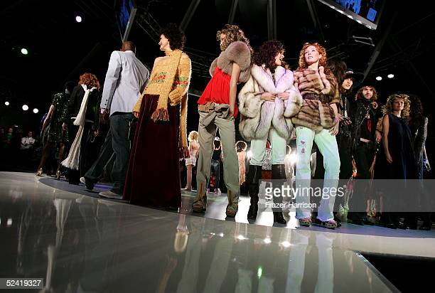 Models walk the runway during the Pret A PSP fashion show to celebrate the launch of the PlayStation handheld entertainment system at the Pacific...