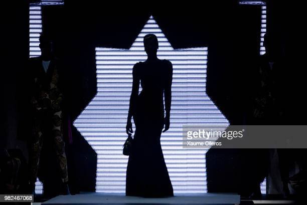 Models walk the runway during the Quiteria X George show at the 16 Dakar Fashion Week at Radison Blu Hotel on June 23 2018 in Dakar Senegal