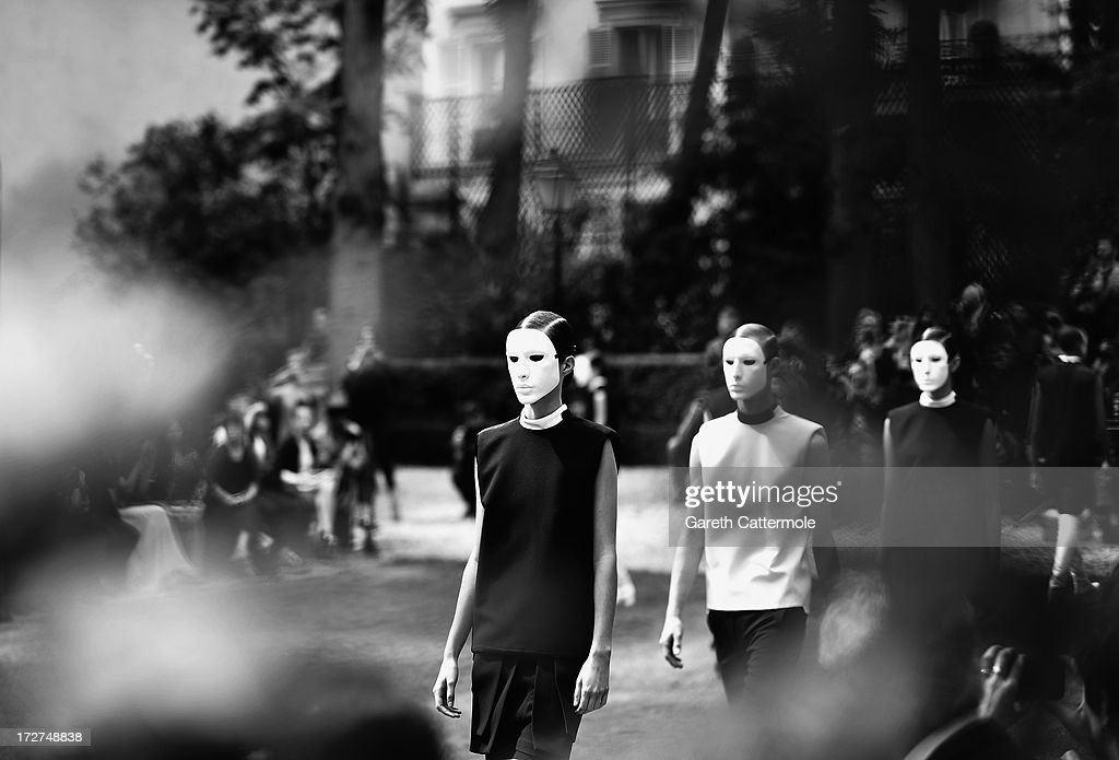 Models walk the runway during the Rad Hourani show as part of Paris Fashion Week Haute-Couture Fall/Winter 2013-2014 on July 4, 2013 in Paris, France.
