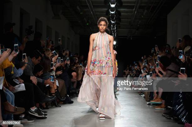 Models walk the runway during the Rahul Mishra show as part of the Paris Fashion Week Womenswear Spring/Summer 2018 on September 30 2017 in Paris...