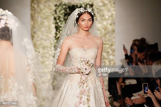 Models walk the runway during the Reem Acra Fall 2015 Bridal Collection show at the Reem Acra Boutique on October 10, 2014 in New York City.