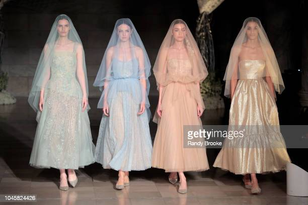 Models walk the runway during the Reem Acra Fall/Winter 2019 bridal show at New York Fashion Week Bridal on October 4 2018 in New York City