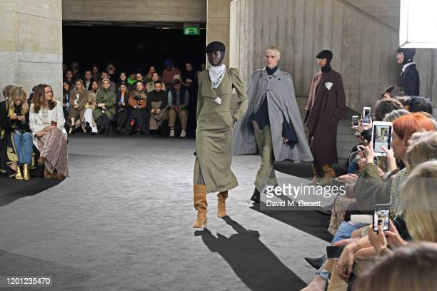 Models walk the runway during the Roland Mouret show during London Fashion Week February 2020 at The National Theatre on February 16 2020 in London...