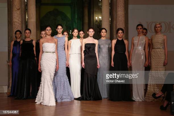 Models walk the runway during the Rolando Santana Spring/Summer 2013 fashion show at Casino Español on November 27 2012 in Mexico City Mexico