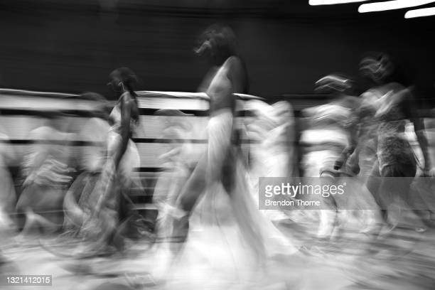 Models walk the runway during the Rumer show during Afterpay Australian Fashion Week 2021 Resort '22 Collections at Carriageworks on June 03, 2021 in...