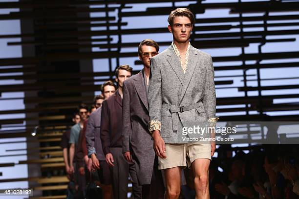 Models walk the runway during the Salvatore Ferragamo show as part of Milan Fashion Week Menswear Spring/Summer 2015 on June 22, 2014 in Milan, Italy.