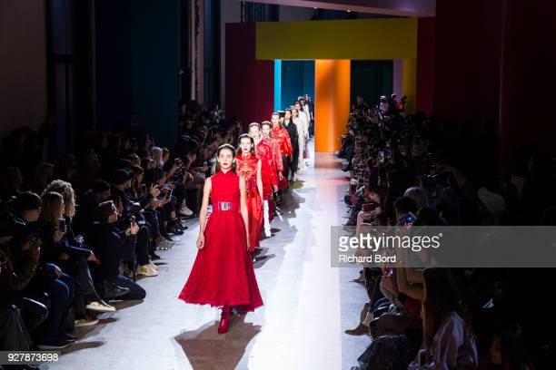 Models walk the runway during the Shiatzy Chen show as part of the Paris Fashion Week Womenswear Fall/Winter 2018/2019 on March 5 2018 in Paris France