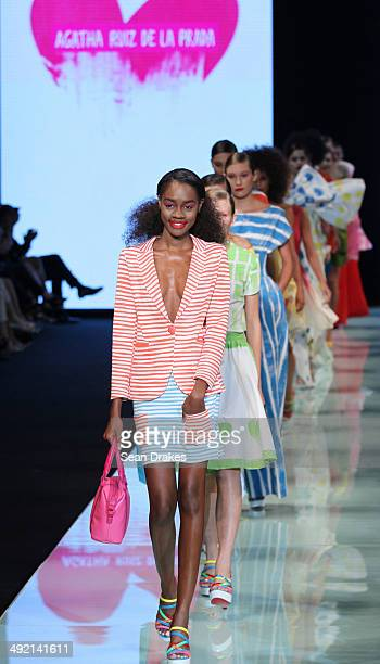 Models walk the runway during the show by Agatha Ruiz de la Prada of Spain at Miami Fashion Week Resort 2014/2015 Day 4 at Miami Beach Convention...