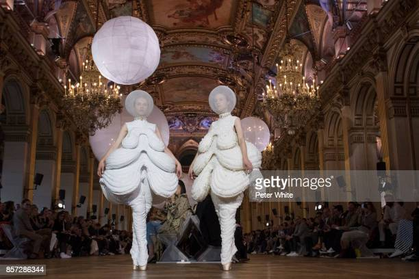 Models walk the runway during the Thom Browne fashion show as part of the Paris Fashion Week Womenswear Spring/Summer 2018 on October 3 2017 in Paris...