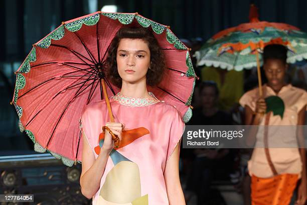 Models walk the runway during the Tsumori Chisato Ready to Wear Spring / Summer 2012 show during Paris Fashion Week at Centorial on October 1, 2011...